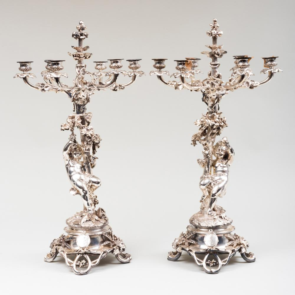 Pair of Christofle Silver Plate Figural Six-Light Candelabra