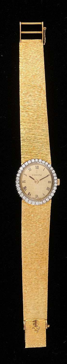 LADY'S 18K GOLD AND DIAMOND CORUM WRISTWATCH
