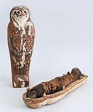 EGYPTIAN CARVED AND PAINTED WOOD FALCON MUMMY CASE AND CLOTH BOUND MUMMY