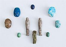GROUP OF THREE EGYPTIAN FAIENCE USHBATIU AND SEVEN GLAZED FAIENCE SCARABS