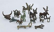 MISCELLANEOUS GROUP OF THIRTEEN ANCIENT BRONZE AND METAL STAG AND ANIMAL FORM PENDANTS