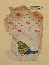 COPTIC TEXTILE FRAGMENT WITH A GREEN BIRD AND ROSE LATTICE