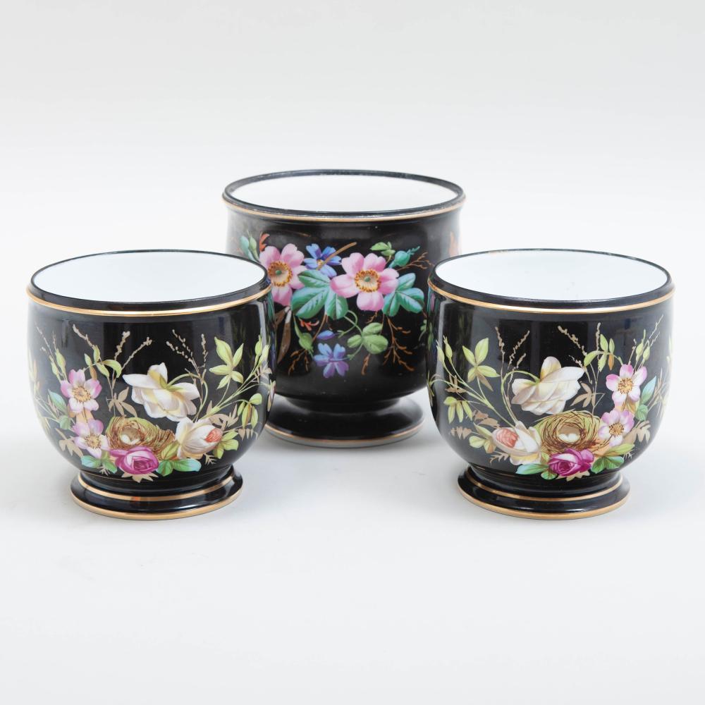 Pair of Paris Porcelain Black Ground Jardinières and a Similar Wine Cooler