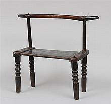 AFRICAN METAL-MOUNTED STAINED HARDWOOD CHIEF'S CHAIR