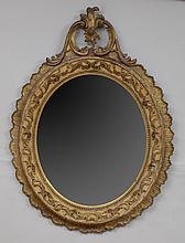 VICTORIAN CARVED AND GILT GESSO AND GILTWOOD OVAL MIRROR