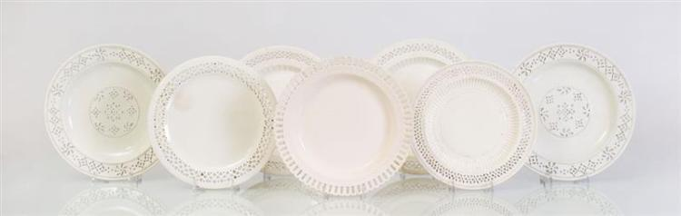 SEVEN ENGLISH GLAZED POTTERY PLATES WITH RETICULATED BORDERS