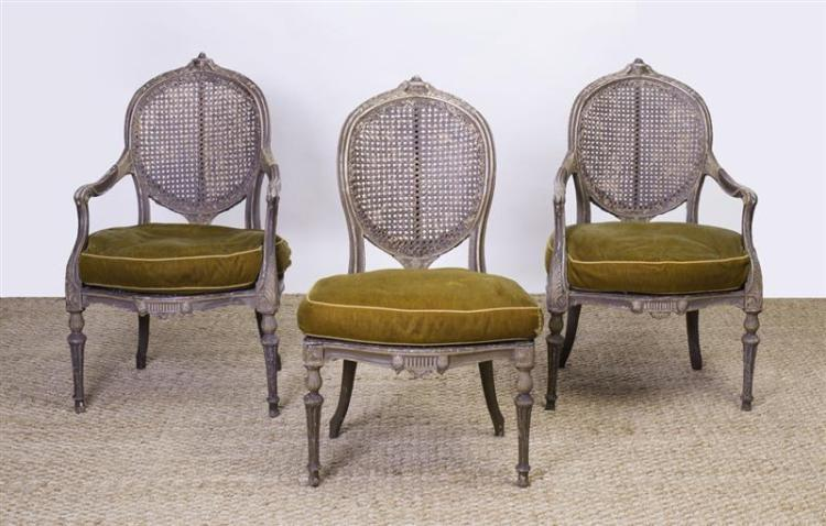 PAIR OF LOUIS XVI STYLE PAINTED AND CANED FAUTEUILS EN CABRIOLET AND A MATCHING FAUTEUIL