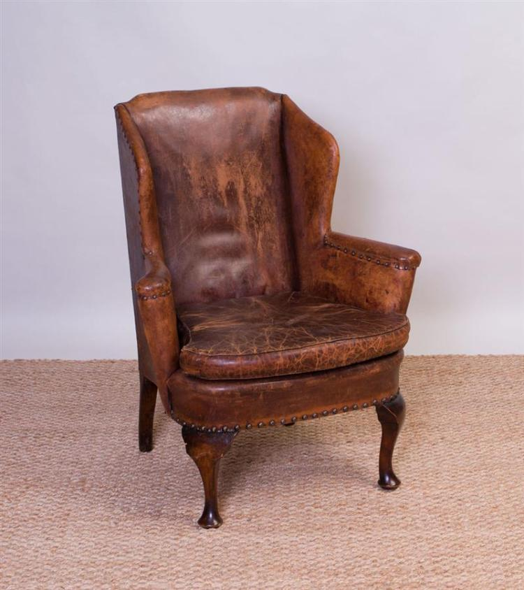 GEORGE III STYLE MAHOGANY AND LEATHER UPHOLSTERED WING CHAIR