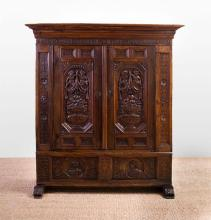 CONTINENTAL CARVED WALNUT ARMOIRE