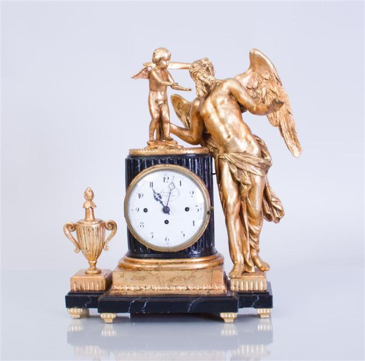 LATE EMPIRE EBONIZED AND PARCEL-GILT WOOD MANTLE CLOCK