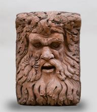 TERRACOTTA FOUNTAIN HEAD IN THE FORM OF A GREEN MAN