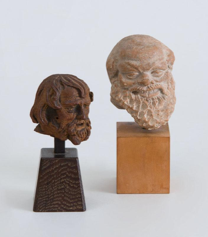ROMAN TERRACOTTA HEAD OF SILENNS AND MEDIEVAL STYLE CARVED WOOD HEAD OF AN APOSTLE