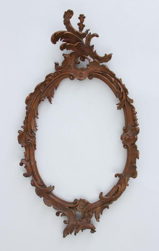 ITALIAN ROCOCO STYLE CARVED GILTWOOD OVAL FRAME