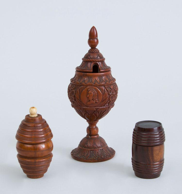 CONTINENTAL CARVED BOXWOOD STEMMED MUSTARD CUP AND COVER AND TWO TREENWARE BARREL-FORM BOXES