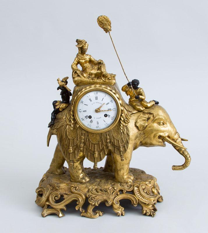RÉGENCE STYLE GILT-BRONZE ELEPHANT-FORMED MANTLE CLOCK