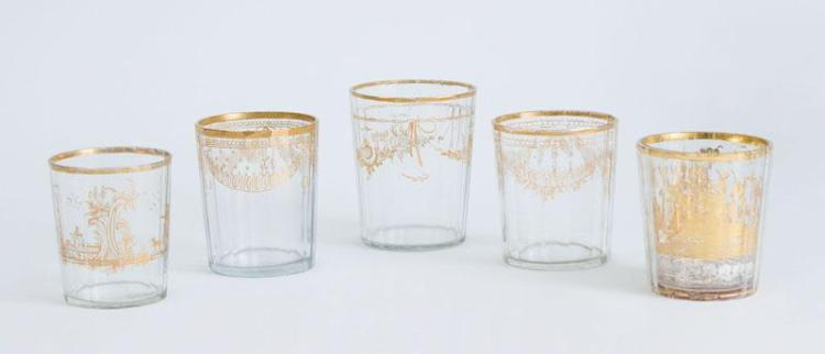 FIVE CONTINENTAL GILT-DECORATED FACETED GLASS TUMBLERS