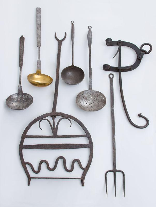 GROUP OF SEVEN WROUGHT-IRON IMPLEMENTS