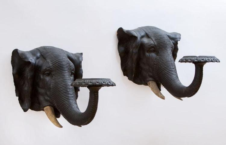 PAIR OF ANGLO-INDIAN CARVED AND PAINTED WOOD ELEPHANT HEAD WALL BRACKETS