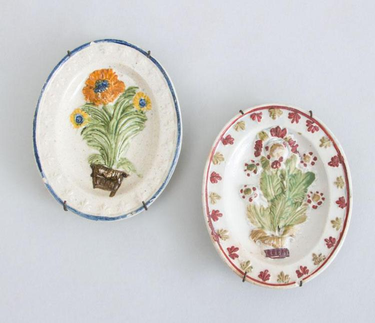TWO ENGLISH CREAMWARE RELIEF-DECORATED MINIATURE OVAL PLATTERS