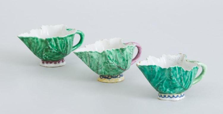 THREE CHELSEA PORCELAIN LEAF-FORM CUPS