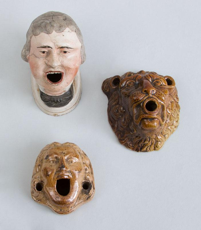 GROUP OF THREE ENGLISH POTTERY MASK HEAD INKWELLS