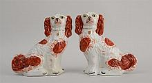 PAIR OF STAFFORDSHIRE MODELS OF SEATED SPANIELS