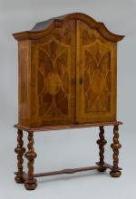 FLEMISH BAROQUE WALNUT AND FRUITWOOD CABINET ON LATER STAND