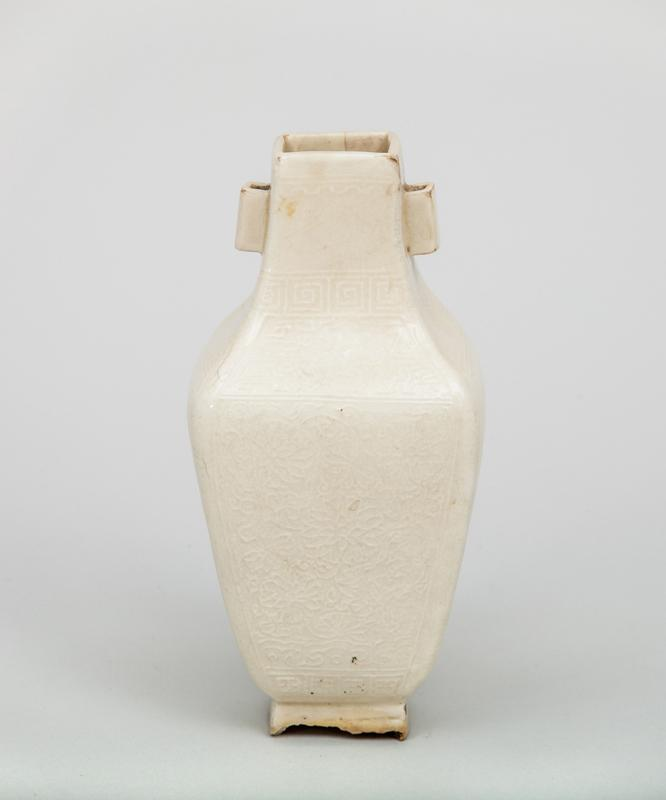 Chinese Relief-Decorated White Glazed Pottery Baluster-Form Vase