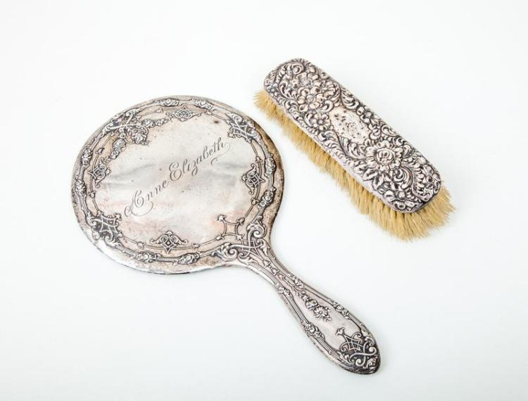 American Silver-Backed Hand Mirror and an American Silver-Backed Brush