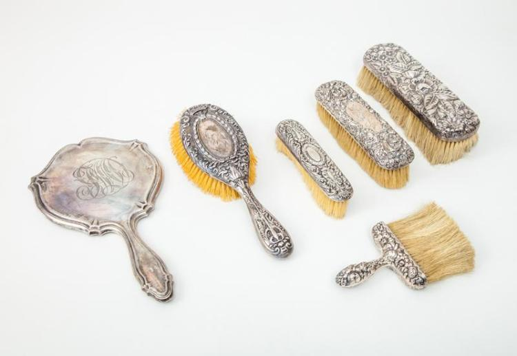 American Monogrammed Silver Hand Mirror and Five Repoussé-Decorated Brush Backs