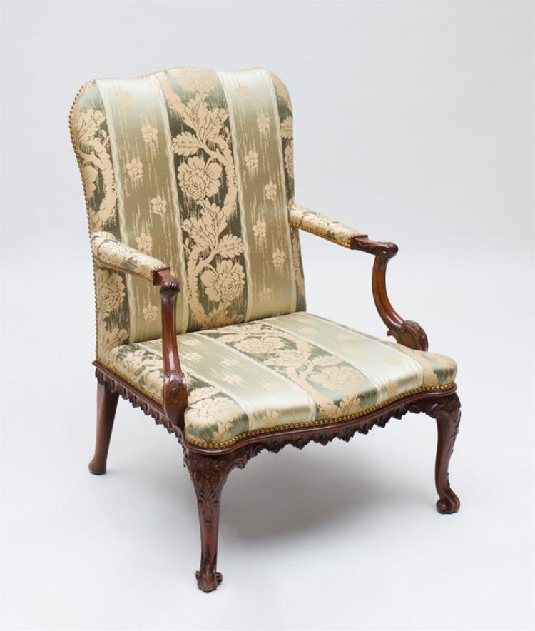 FINE GEORGE II CARVED MAHOGANY LIBRARY ARMCHAIR