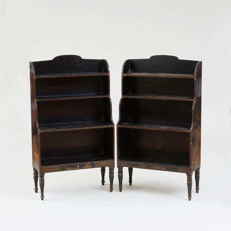 TWO NEARLY IDENTICAL REGENCY STYLE BLACK-PAINTED AND PARCEL-GILT OPEN BOOKCASES