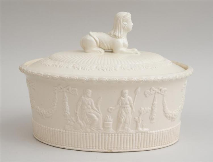 CONTINENTAL IVORY-GLAZED FAIENCE RELIEF-DECORATED TUREEN AND COVER