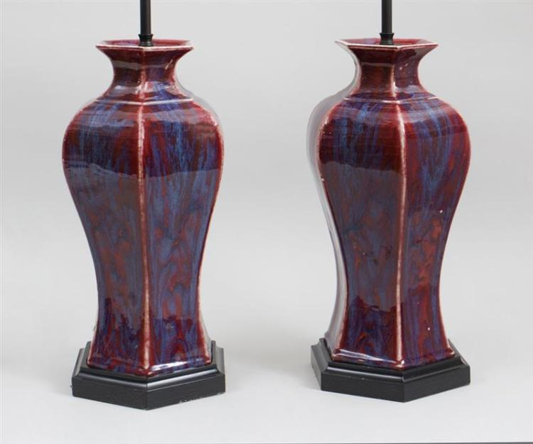 PAIR OF CHINESE OXBLOOD-GLAZED PORCELAIN HEXAGONAL VASES, NOW MOUNTED AS LAMPS