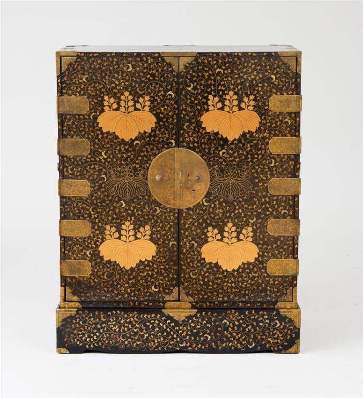 JAPANESE GILT-METAL-MOUNTED BLACK LACQUER AND PARCEL-GILT CABINET ON STAND
