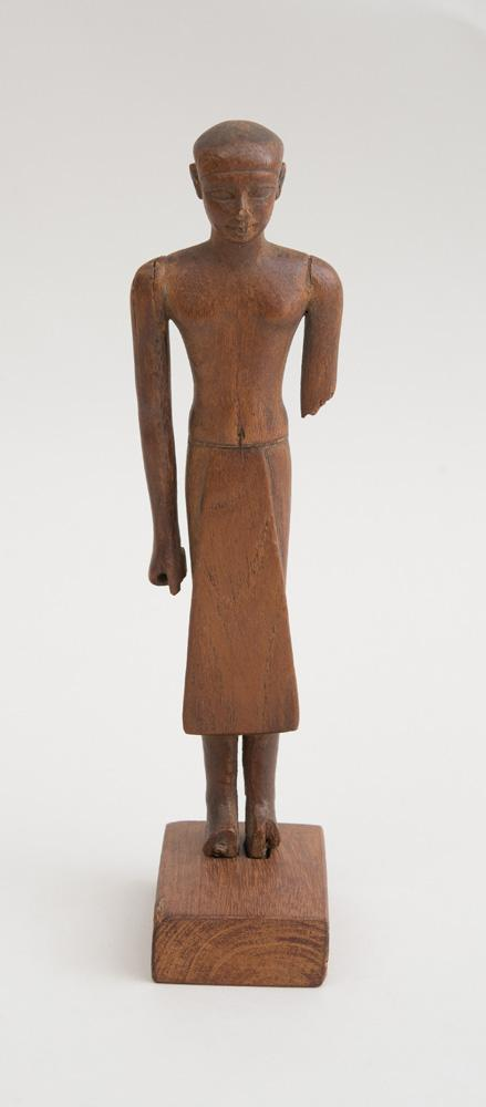 RARE EGYPTIAN CARVED WOOD FIGURE OF A PRIEST