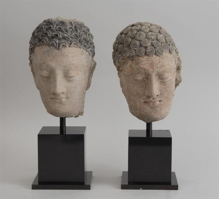 TWO GANDHARAN CLAY BUSTS, ONE OF BUDDHA, THE OTHER A BODHISATTVA