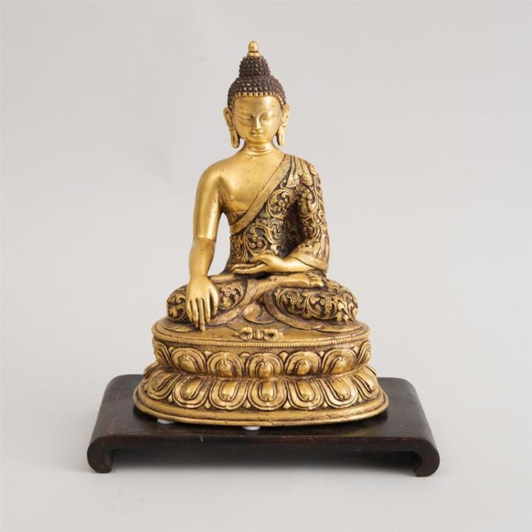 SOUTHEAST ASIAN HOLLOW-CAST GILT-BRONZE FIGURE OF BUDDHA