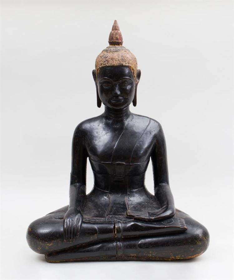 THAI CARVED AND BLACK-PAINTED WOOD FIGURE OF THE SEATED BUDDHA