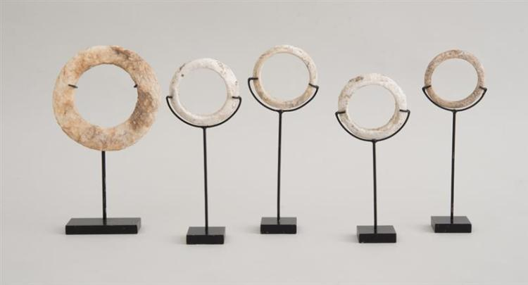 GROUP OF TEN CHINESE ARCHAIC CALCIFIED MARBLE BANGLES