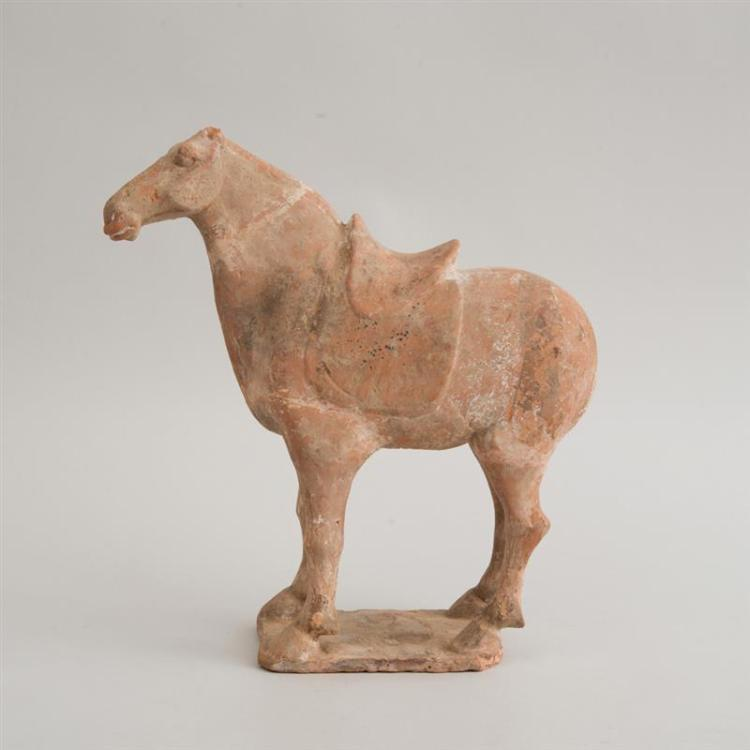 CHINESE TANG STYLE UNPAINTED POTTERY FIGURE OF A HORSE