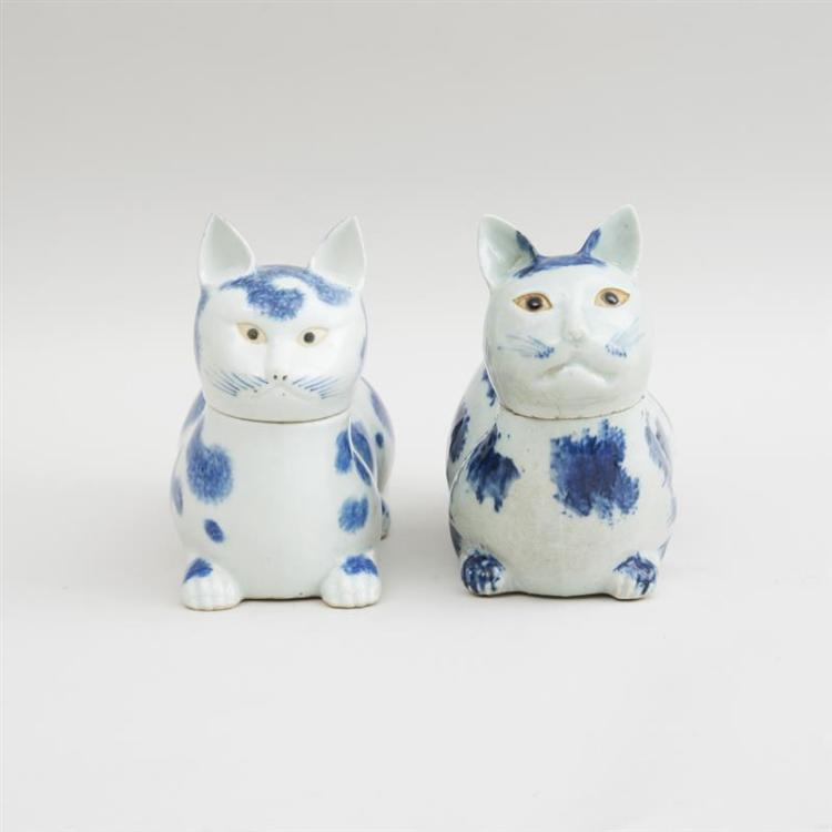 PAIR OF CHINESE BLUE SPOTTED SPONGED CAT-FORM EWERS AND COVERS