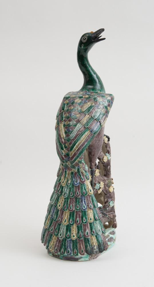 CHINESE POLYCHROME-GLAZED PORCELAIN FIGURE OF A PEACOCK