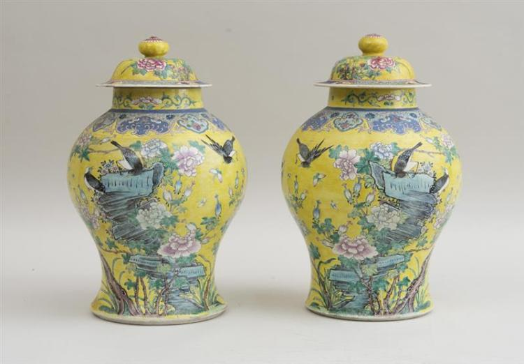 PAIR OF CHINESE YELLOW-GROUND FAMILLE ROSE PORCELAIN BALUSTER-FORM JARS AND COVERS