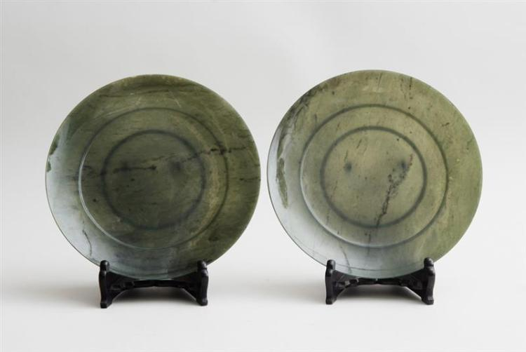PAIR OF CHINESE SPINACH GREEN JADE FOOTED PLATES