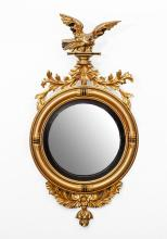 LATE FEDERAL STYLE EBONIZED AND PARCEL-GILT CONVEX MIRROR