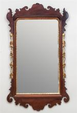 CHIPPENDALE MAHOGANY AND PARCEL-GILT MIRROR