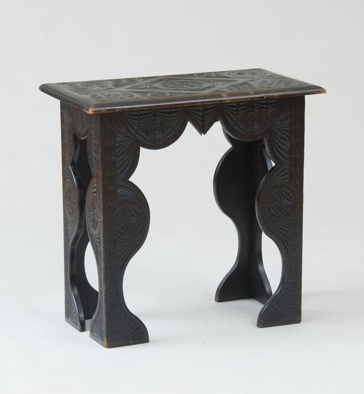 SPANISH COLONIAL CARVED EBONIZED SIDE TABLE