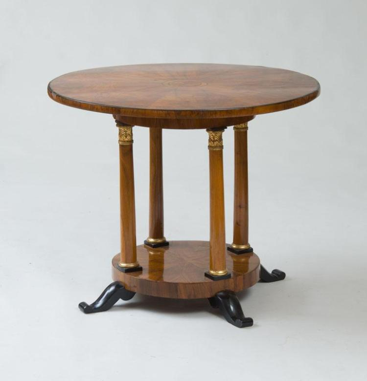 FINE AUSTRIAN NEOCLASSICAL BLACK WALNUT, EBONIZED AND PARCEL-GILT CENTER TABLE
