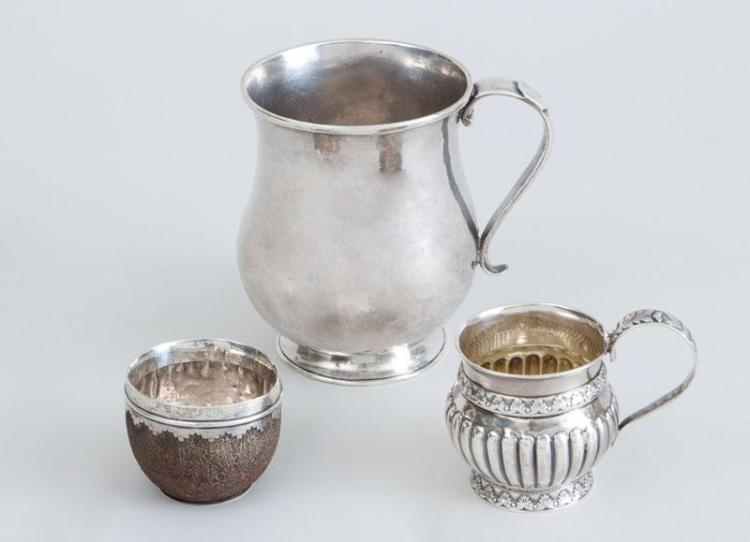LATIN AMERICAN SILVER MUG, A CRESTED SILVER-RIMMED COCONUT COP AND GEORGE IV SILVER CUP